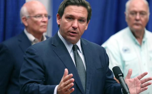 """Florida Gov. Ron DeSantis speaks last month at a monoclonal antibody treatment center. He said last week that if someone opts not to get the COVID-19 vaccine, """"It really doesn't impact me or anyone else."""""""