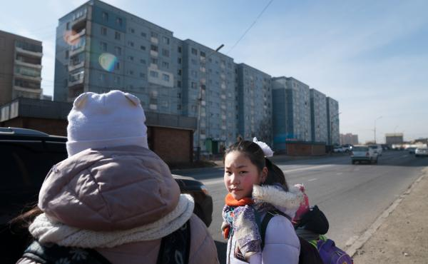 Muguntuul Oyutan, 11, walks to school with her sister and friends in Ulaanbaatar, the capital of Mongolia. Mongolia is the world's most sparsely populated nation, and an increasing proportion of its citizens reside in the capital.