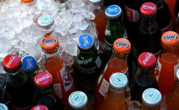 Soda bottles displayed in a San Francisco market.A federal appeals court blocked a city law requiring advertisement warnings on the potential health impacts of sugary drinks.