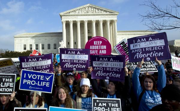 Anti-abortion activists protest outside of the U.S. Supreme Court. The Supreme Court has rejected laws that tie abortion rights to a specific week in a woman's pregnancy, but this is the first time a judge has struck down the 1973 law.