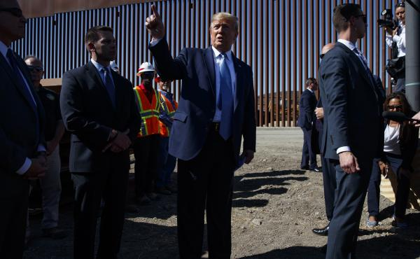 President Trump talks with reporters after touring a section of the southern border wall in September in Otay Mesa, Calif.