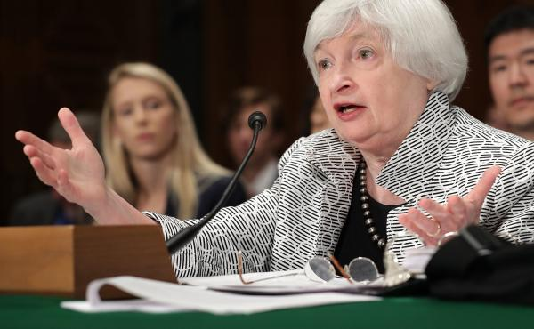 Federal Reserve Board Chair Janet Yellen says the process of unwinding the central bank's massive bond holdings will be gradual.