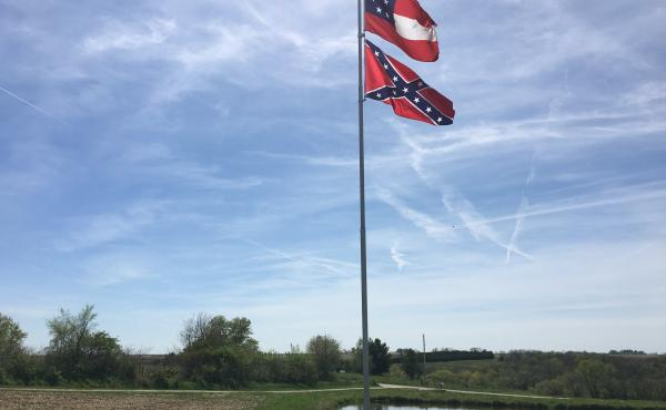 Two different variations of Confederate flags fly in Owen Golay's yard in rural Pleasantville, Iowa.