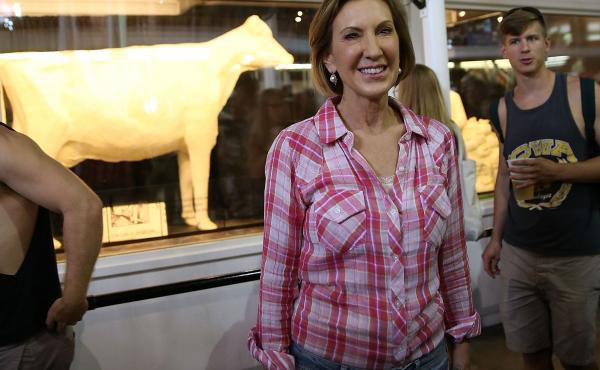 Republican presidential candidate Carly Fiorina poses for a photo in front of the Butter Cow while touring the Iowa State Fair on Monday in Des Moines.