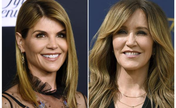 Actresses Lori Loughlin (left) and Felicity Huffman appeared in federal court in Boston on Wednesday along with a group of other parents. A total of 50 people have been charged in connection with the alleged years-long scam.