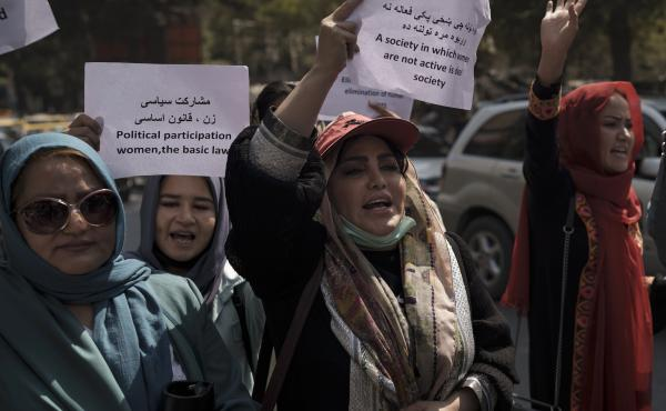 Women march to demand their rights under the Taliban rule during a demonstration near the former Women's Affairs Ministry building in Kabul, Afghanistan, on Sunday. The interim mayor of Afghanistan's capital said that many female city employees have been