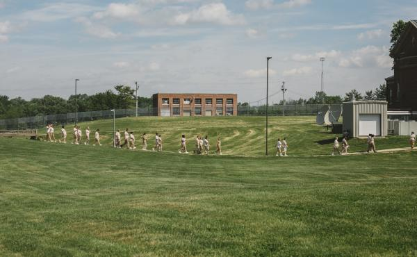 Women walk through the courtyard to lunch at the Indiana Women's Prison in Indianapolis on May 17.