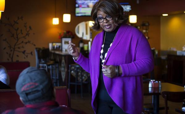 Ferguson Councilwoman Ella Jones meets with patrons at Drake's Place restaurant. Jones is seeking to become Ferguson's first African-American mayor.