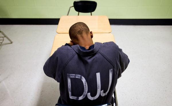 A juvenile resident sits in a classroom at the Department of Juvenile Justice's Metro Regional Youth Detention Center in Atlanta.