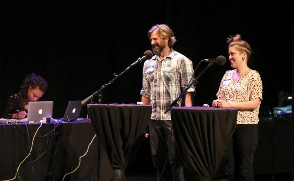 Contestants Dennis Feeney and Lynsi Burton appear on Ask Me Another at the Moore Theatre, in Seattle, Washington.