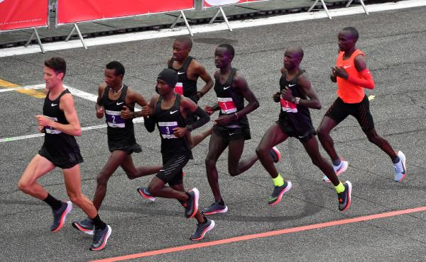 A team of elite runners acted as pacers and decreased wind resistance for Eliud Kipchoge (right) as he attempted a sub-two-hour marathon in Monza, Italy, on May 6.