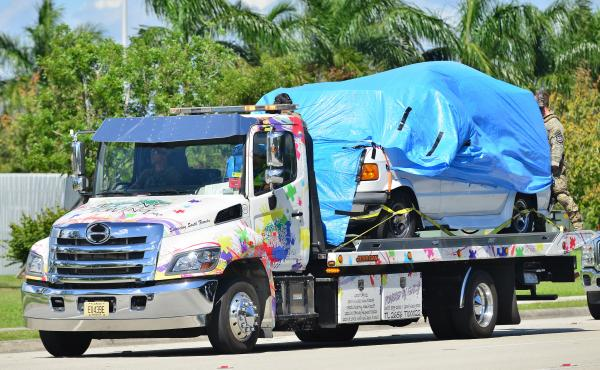 A van belonging to Cesar Sayoc covered in blue tarp was towed by FBI investigators to FBI Miramar Headquarters. The suspect was arrested in connection to the string of pipe bombs mailed to prominent Democrats across the country.