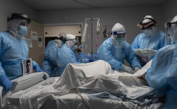 Medical staff members treat a patient with COVID-19 last week in the intensive care unit of United Memorial Medical Center in Houston. Once a COVID-19 vaccine is available, experts say immunizing health workers first is the best way to curb deaths and sto