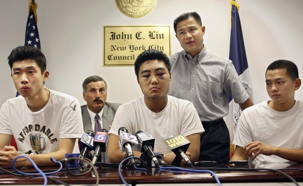 John Lu (left), Reynold Liang (center) and David Wu (right) during a news conference in Queens, N.Y., after being the victims of a hate crime in 2006. New York City council member David Weprin (second left) and John C. Liu look on.