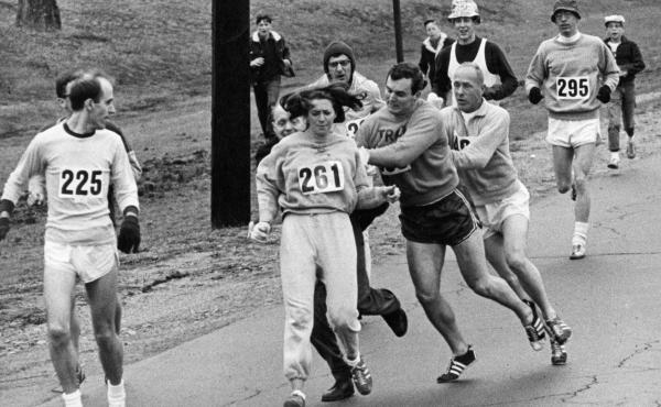 In 1967, Kathrine Switzer was spotted early in the Boston Marathon by race director Jock Semple, who tried to rip the number off her shirt and remove her from the race. Switzer's friends intervened, allowing her to make her getaway to become the first wom