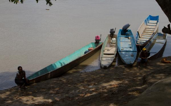 Fishermen wait to help people going to Colombia across the Arauca River near San Fernando de Apure in Venezuela in February 2017. More than 1 million Venezuelans are estimated to be living in Colombia.