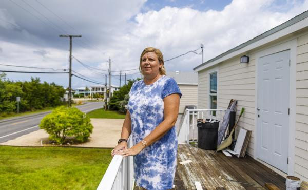 When buying her new home in Big Pine Key, Fla., Amy Tripp closed early, just before federal flood insurance rates rose by thousands of dollars. Her rate will still go up more slowly over time.