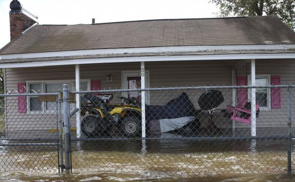 A house is surrounded by flood water in Lumberton, N.C., on Monday.