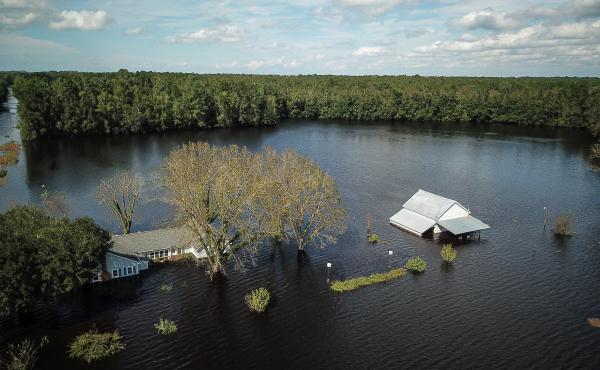 A flooded farm stands next to the Lumber River on Monday in this aerial photograph taken after Hurricane Florence hit Lumberton, N.C.