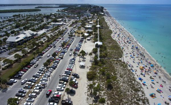 Englewood Beach in Charlotte County, Fla., was crowded on March 20. Public gatherings like these will be prohibited in Florida beginning Thursday.