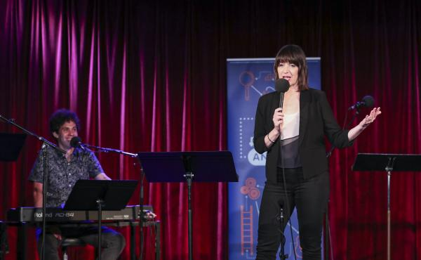 Ophira Eisenberg performs alongside guest house musician Julian Velard on Ask Me Another at the Bell House in Brooklyn, New York.