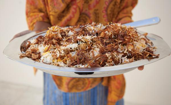 Zanzibari biryanai, a dish involving spiced poached chicken, fried onions, a rich gravy and rosewater- and saffron-scented rice. Zanzibar was part of Oman until 1965.