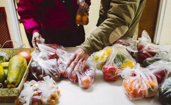 Two people at a food pantry in Portland, Maine, choose items from a display of produce. Several food banks around the country have been trying something new to get people to choose healthier foods. And it's working.