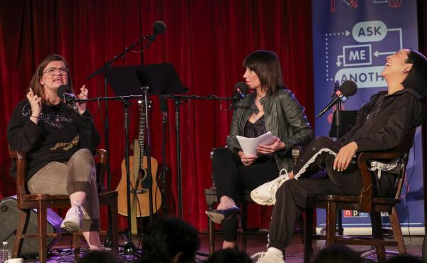 Lesyle Headland and Greta Lee play a game on Ask Me Another at the Bell House in Brooklyn, New York.