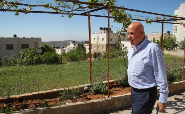 Omar Omar outside his family's home in the village of Deir Jarir. After living in the U.S. for decades, he sees the West Bank with the eyes of an outsider.