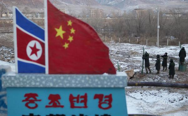 "A concrete marker with the North Korean and Chinese national flags has the words ""China North Korea Border,"" at a crossing in the Chinese border town of Tumen in eastern China's Jilin province."