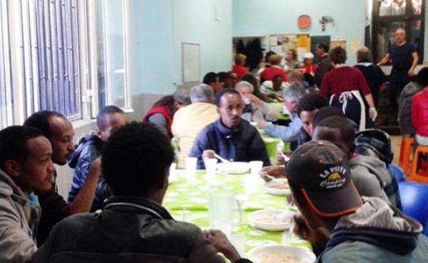 Hundreds of migrants have found support at the mess hall of the Caritas help center in Catania, where one volunteer says the crisis is pitting the poor against the poor, referring to homeless Italians and the newly arrived migrants.