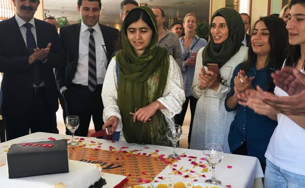 "Malala cuts a birthday cake in the shape of a book at a restaurant in Dohuk. The youngest Nobel laureate turned 20 on July 12 in Dohuk,€"" five years after she was shot in the head by a Taliban gunman in Pakistan."