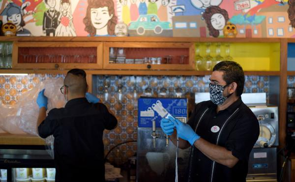 Workers prepare takeout orders May 1 in Houston. For more than two out of three unemployed workers, jobless benefits exceed their old pay, researchers say. That discrepancy can raise awkward questions for workers, bosses and policymakers.