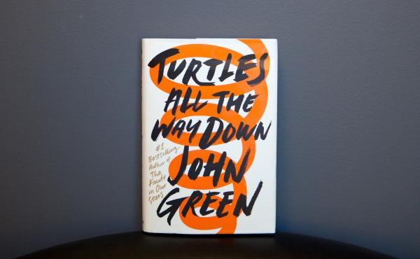 """The teen protagonist in John Green's latest novel, Turtles All The Way Down, has a type of anxiety disorder that sends her into fearful """"thought spirals"""" of bacterial infection and death."""