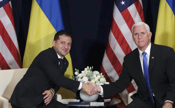 Ukrainian President Volodymyr Zelenskiy shakes hands with Vice President Mike Pence, in Warsaw, Poland on Sept. 1, 2019.