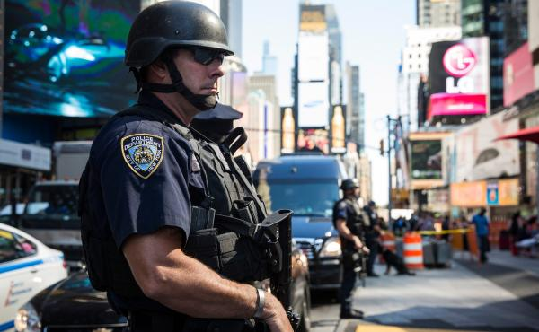 New York City police officers stand guard in Times Square earlier this month after a blog affiliated with the so-called Islamic State militants mentioned the area as a target for bombing.