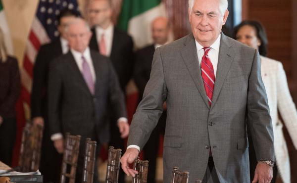 Secretary of State Rex Tillerson makes his way to his seat before the Strategic Dialogue on Disrupting Transnational Criminal Organizations at the State Department on Dec. 14.