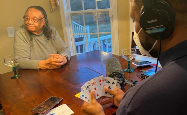 Molly Garris, 94, moved in with one of her daughters during the pandemic. The move has meant she's able to enjoy a game of spades, one of her favorite pastimes, with her family, including her grandson-in-law, All Things Considered producer Jason Fuller.