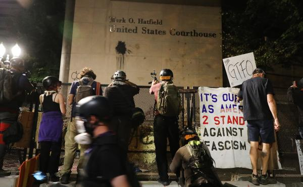 Protesters gather in front of the Mark O. Hatfield federal courthouse in downtown Portland, where some demonstrators have been arrested and others released from jail on the condition that they not attend any more protests.