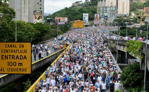 A crash in oil prices and political instability under President Nicolas Maduro has led to food shortages. And that has prompted almost daily street protests by thousands of Venezuelans. Here opposition activists march on the Francisco Fajardo Highway in C