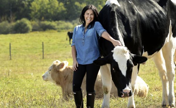 Tracey Stewart poses with Tweed and Gidget at Farm Sanctuary's Watkins Glen, N.Y., location. Stewart is the founder of the online magazine, Moomah.