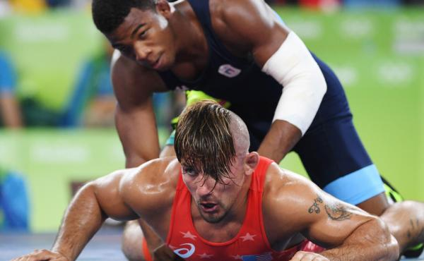 U.S. wrestler Frank Molinaro (red) battles Italy's Frank Chamizo Marquez in the 65-kg (143 pound) bronze medal bout at the 2016 Summer Olympics in Rio de Janiero.  Molinaro, who lost to Marquez, recently retired from the sport when the 2020 Olympics were