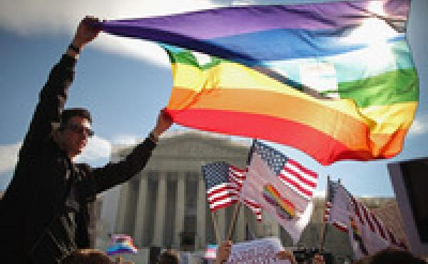 In her new book, Forcing the Spring, investigative reporter Jo Becker goes behind the scenes in the fight for marriage equality. Above, Eric Breese of Rochester, N.Y., joins hundreds of others to rally outside the Supreme Court during oral arguments in a