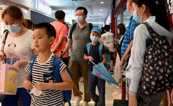 Students and parents walk after a private after-school session in Beijing's Haidan district, where competition is cutthroat for a spot in top schools.