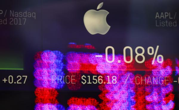The SEC has accused a former Apple executive of using advance information about the company's finances to sell off stock and avoid losses. Here, stock numbers for Apple are displayed on a screen at the Nasdaq MarketSite in Times Square last month in New Y