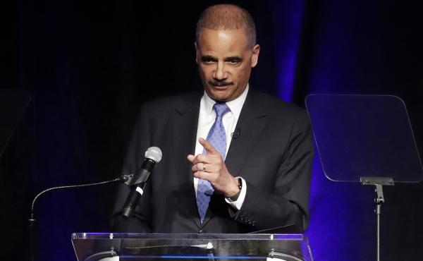 Former Attorney General Eric Holder speaks at the Peabody Hotel in Memphis, Tenn., in April 2018.