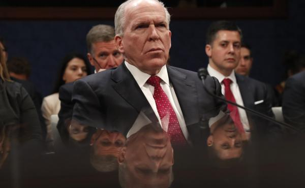Former CIA Director John Brennan prepares to testify on Capitol Hill on Tuesday.