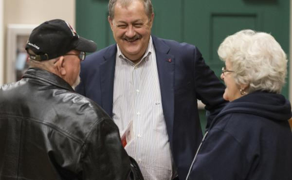 Former Massey CEO and West Virginia Republican Senatorial candidate Don Blankenship, greets supporters Doug Smith, left, and Wanda Smith, right, prior to a town hall in Logan, W.Va., on Jan. 18.