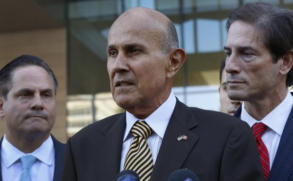 Ex-LA County Sheriff Lee Baca, with attorneys David Hochman, left, and Nathan Hochman, talks to the media as he leaves federal court in Los Angeles on Wednesday, after being convicted of obstructing an FBI corruption investigation of jails he ran and of l