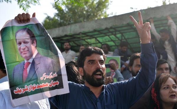 Pakistani supporters of ousted Prime Minister Nawaz Sharif carry posters and banners outside the high court building in Islamabad on Wednesday as they celebrate his release from prison. Sharif is appealing the conviction, which followed a major corruption